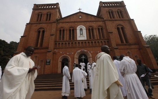 Members of the clergy arrive for Mass in late 2013 at Notre Dame Cathedral of the Immaculate Conception in Bangui, Central African Republic. Catholic leaders in the Central African Republic praised the courage of missionary priests and nuns who remain in the country during the current conflict, despite offers of evacuation. (CNS photo/Luc Gnago, Reuters) (Feb. 20, 2014) See CAR-MISSIONARIES Feb. 20, 2014.